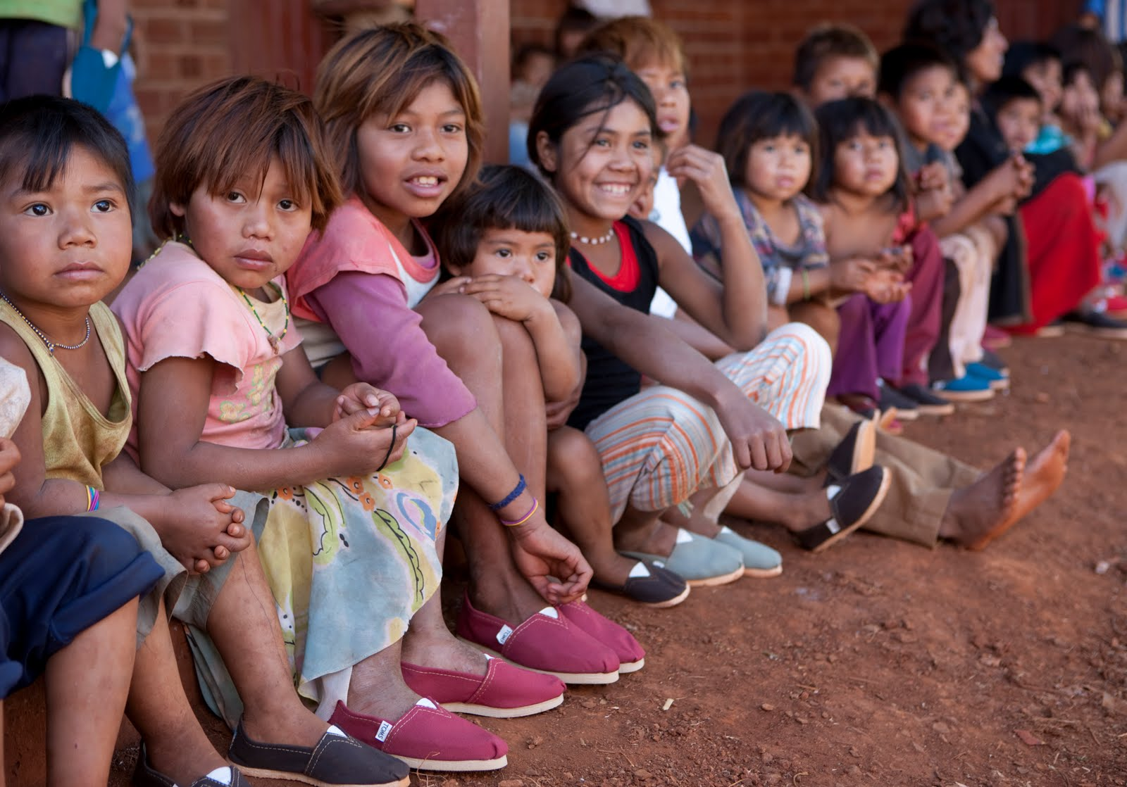 children with colored shoes