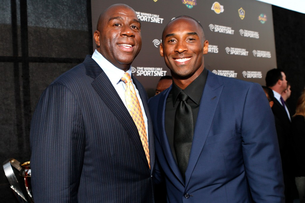 Magic Johnson, left, and Kobe Bryant  arrive at the Time Warner Cable Sports launch event hosted by Time Warner Cable Sports on Monday, Oct. 1, 2012, in Los Angeles. (Photo by Todd Williamson/Invision for Time Warner Cable/AP Images)